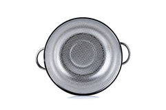 Stainless colander with bail on white Stock Images