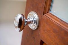 Stainless Door Knob On Wood Door Stock Images