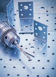 Stainless drilled angle fasteners and metal drill Stock Images