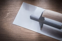 Stainless glazed plastering trowel top view construction concept Royalty Free Stock Photography