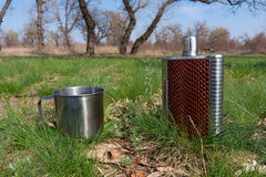 Stainless hip flask and cup Royalty Free Stock Images