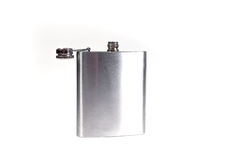 Stainless hip flask isolated on a white background. Alcohol addiction. Stock Photo
