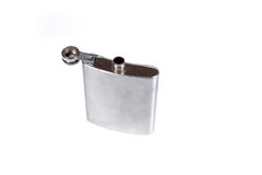 Stainless hip flask isolated on a white background. Alcohol addiction. Royalty Free Stock Photo