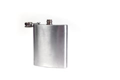 Stainless hip flask isolated on a white background. Alcohol addiction. Stock Image