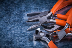Stainless insulated electric pliers nippers on metallic backgrou Royalty Free Stock Image