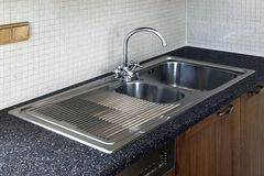 Stainless kitchen sink Royalty Free Stock Photo