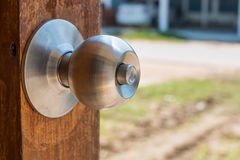 Stainless knob. On door Royalty Free Stock Photo