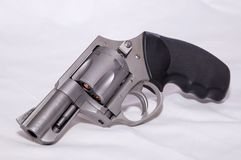 A stainless 357 magnum revolver. Shown on a white background stock photos