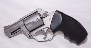 A stainless 357 magnum revolver. Shown on a white background stock image