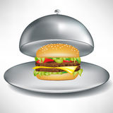 Stainless open catering tray with burger. Stainless open catering tray with cheese burger Royalty Free Stock Photography