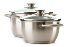Stainless pans on a white Royalty Free Stock Photography