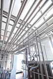 Stainless pipes in factory Stock Photography