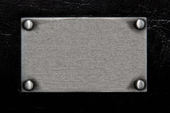 Stainless plate with rivet Royalty Free Stock Images