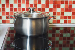 Stainless pot on cooker Royalty Free Stock Photos