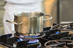 Stainless pot cooking Royalty Free Stock Image