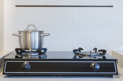Stainless pot on gas stove Stock Photo