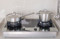 Stainless pot on gas stove Stock Photography