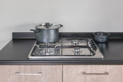 Stainless pot on gas stove Royalty Free Stock Photo