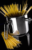 A stainless pot with spaghetti Stock Images