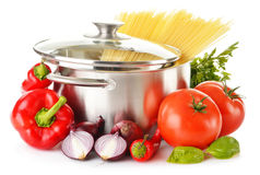 Stainless pot with spaghetti and variety of raw vegetables Royalty Free Stock Image