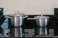 Stainless pots in modern kitchen Stock Photography