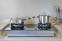 Stainless pots in modern kitchen Royalty Free Stock Images