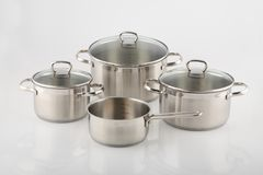 Stainless pots and pans on white background. Royalty Free Stock Photo