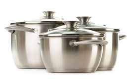 Stainless pots on a white Stock Images