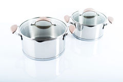 Stainless pots on a white background Royalty Free Stock Photo
