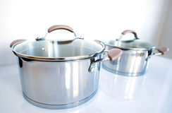 Stainless pots on a white background Royalty Free Stock Photography
