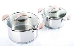 Stainless pots on a white background Royalty Free Stock Image