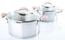Stainless pots on a white background Stock Photos