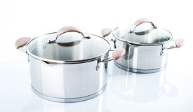 Stainless pots on a white background Stock Images