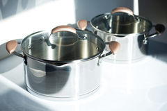 Stainless pots on a white background Royalty Free Stock Images