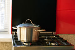 Stainless saucepan on a gas stove Royalty Free Stock Images