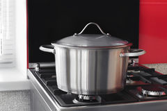 Stainless saucepan on a gas stove Royalty Free Stock Photo