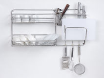 Stainless shelf with kitchen utensil Royalty Free Stock Image