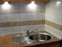 Stainless sink. Stainless steel sink in the modern kitchen Royalty Free Stock Photography