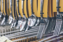 Stainless spoons and fork set hanging in the store. Shopping mall, Bali island, Indonesia. Stainless spoons and fork set hanging in the store. Shopping mall Stock Photo