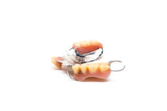 Stainless steal denture. Old man real denture with plastic type and stainless steal type royalty free stock photos