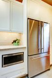 Stainless steal refridgirator with microwave. Royalty Free Stock Images