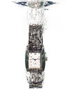 A stainless steel analog watch falling in water Royalty Free Stock Photography