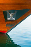 Stainless Steel Anchor and Plate Mounted on a Wooden Yacht. Highly polished, stainless steel anchor and plate, mounted to the wooden hull of a luxury yacht at Royalty Free Stock Image