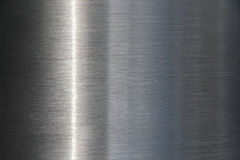 Stainless Steel background with a streak of light Stock Image