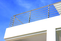 Stainless steel balcony guard rail. Image of balcony guard rail of a building made of stainless steel with blue sky background Royalty Free Stock Image