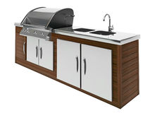 Stainless steel barbecue with wooden table Royalty Free Stock Images