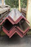 Stainless steel beams deposited in stacks. Stainless steel construction beams deposited in stacks in a deposit Stock Photos