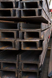 Stainless steel beams deposited in stacks. Stainless steel construction beams deposited in stacks in a deposit Royalty Free Stock Photography