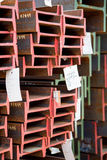 Stainless steel beams deposited in stacks. Stainless steel construction beams deposited in stacks in a deposit Royalty Free Stock Photos