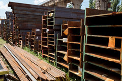 Stainless steel beams deposited in stacks. Stainless steel construction beams deposited in stacks in a deposit Stock Photo